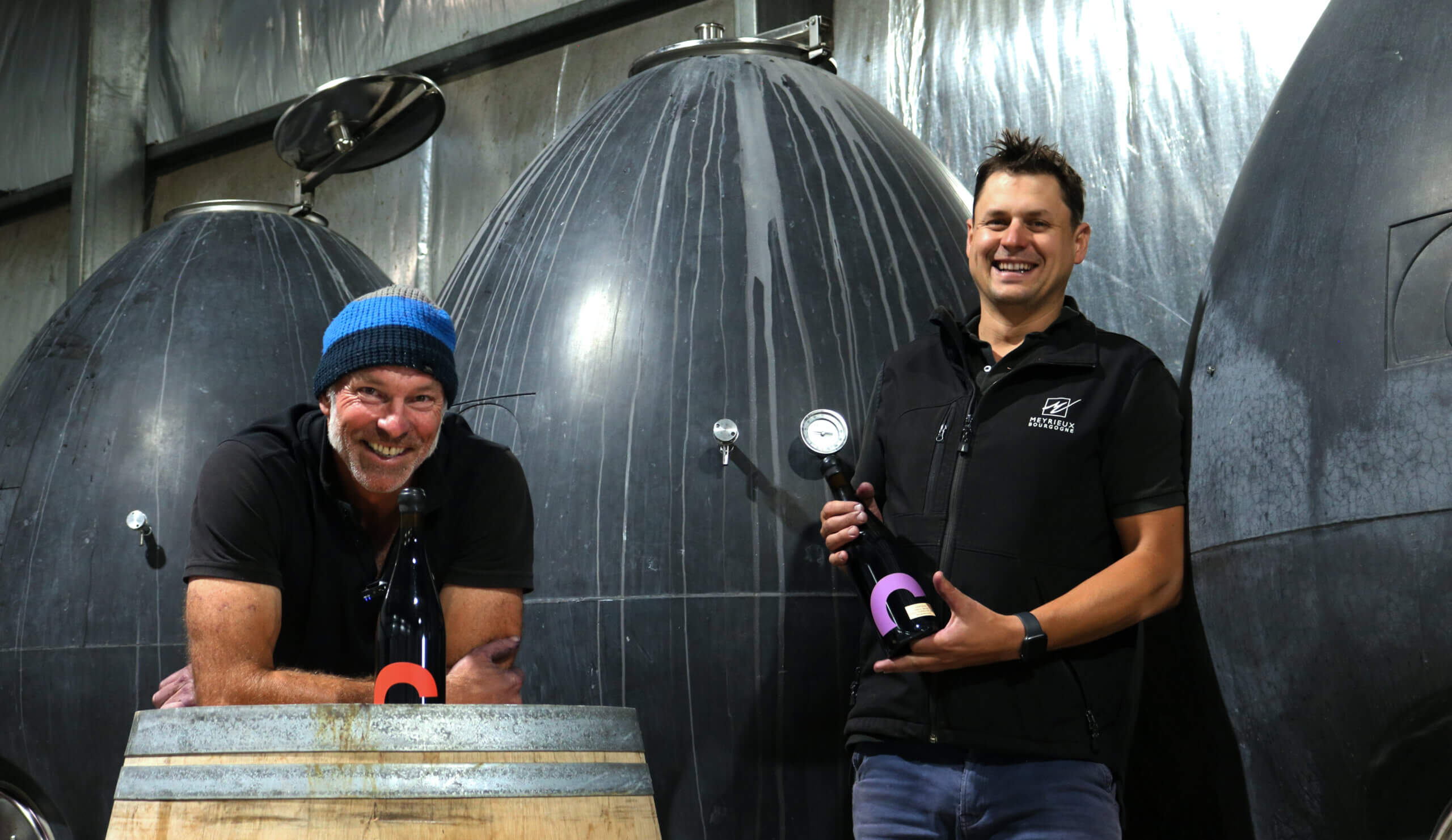Mike and Josh in winery hoding Gemtree Grenache